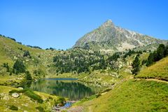 Neouvielle national nature reserve, Lac du Milieu, French Pyrenees. stock photo