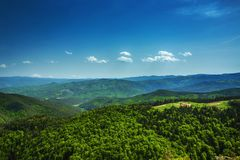 Beautiful mountain landscape, with mountain peaks covered with forest and a cloudy sky. Bulgarian mountain, Europe. Beautiful mountain landscape, with mountain stock image