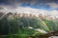 Beautiful mountain landscape with rainbow Stock Photo