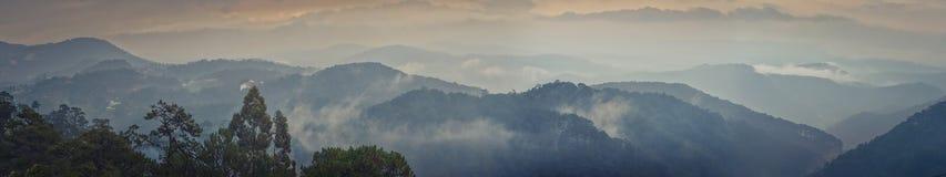 Beautiful mountain landscape at rainy day. Dalat, Vietnam. Panorama. Beautiful mountain landscape at rainy day, fog over the hills. Dalat, Vietnam. Panorama royalty free stock image