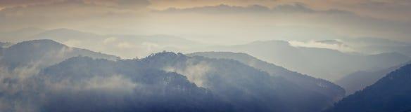 Beautiful mountain landscape at rainy day. Dalat, Vietnam. Panorama. Beautiful mountain landscape at rainy day, fog over the hills. Dalat, Vietnam. Panorama royalty free stock photo