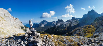Beautyfull mountain panorama. Beautiful mountain landscape. Several massive rocks in the foreground. Mountains are visible to the horizon. Cloudy sky with the Stock Photography