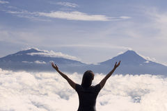 Beautiful mountain landscape with silhouette of woman stock photography