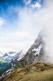 Beautiful mountain landscape with snow in fog and sky Stock Images