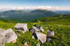 Beautiful mountain landscape on summer morning. Boulders among the grass on hillside Royalty Free Stock Image