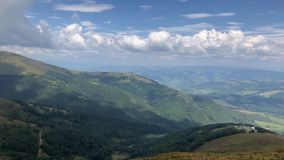 Beautiful mountain landscape from the top of the mountain on a summer day. The sky with beautiful clouds stock footage