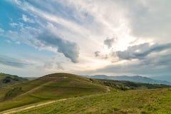 Beautiful mountain landscape with trees and a cloudy morning sky. Dumesti, Salciua, Apuseni, Romania stock photography