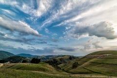 Beautiful mountain landscape with trees and a cloudy morning sky. Dumesti, Salciua, Apuseni, Romania stock photos