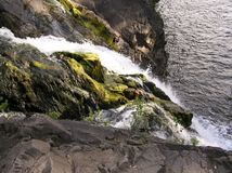 Mountain low waterfall with a rapid current. Beautiful mountain low waterfall with a rapid current in Karelia royalty free stock photos