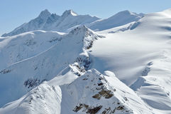 Beautiful mountain massif covered in snow at winter Stock Photos