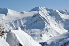 Beautiful mountain massif covered in snow at winter Royalty Free Stock Image