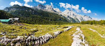 Mountain panorama. Beautiful mountain panorama. There are big stones in the foreground. Ridge goes over the horizon. There is a forest at the foot of the Royalty Free Stock Images
