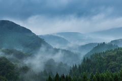 Beautiful mountain range covered with fog and rain in Yufuin, Oi Royalty Free Stock Photo