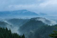 Beautiful mountain range covered with fog and rain in Yufuin, Oita, Japan royalty free stock photography