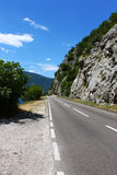 Beautiful mountain road in Montenegro. Beautiful mountain road with a steep cliff on the right and vegetation on the left in Montenegro stock photos
