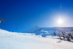 Beautiful mountain scene at alpine ski resort. At sunny winter day Royalty Free Stock Image