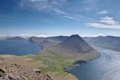 Beautiful mountain scenery in the Faroe Islands. Beautiful mountain scenery with the majestic Malinsfjall mountain and Viðareiði settlement on the Viðoy royalty free stock photos