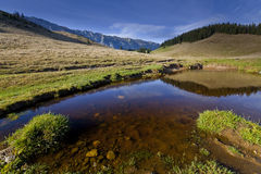 Beautiful mountain scenery with lake reflection Royalty Free Stock Images