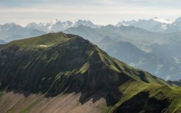 Beautiful mountain scenery in the swiss alps with cross on the mountain peak. Brienzer rothorn stock photo