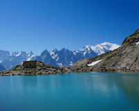 Beautiful blue lake in European alps, with Mont Blanc in the background Royalty Free Stock Photography