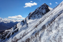 Beautiful mountain scenic landscape of the Main Caucasus ridge with snowy peaks at winter Royalty Free Stock Photo