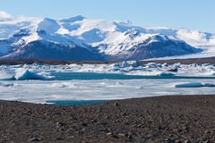 Beautiful mountain show and ice lake in Jokulsarlon Royalty Free Stock Image
