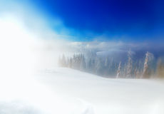 Beautiful mountain snowy landscape and snow covered trees. Beautiful sunny day in the mountains. Royalty Free Stock Image