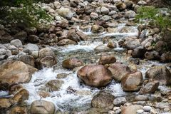 Beautiful mountain stream flows through the stony,rocky riverbed. stock photography