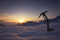 Beautiful mountain sunset. With ice axe in the background stock photography
