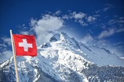 Beautiful mountain with Swiss flag Stock Photos