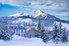 Beautiful mountain town on winter morning in Colorado. Beautiful Colorado mountain town in winter. Snowcapped mountains and houses. Silverthorne, Colorado, USA stock photography