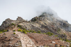 Beautiful mountain trail path near Pico do Arieiro on Madeira island, Portugal Stock Image