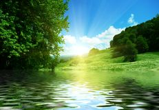 Beautiful mountain valley. Reflection on river surface stock photography