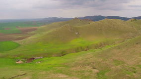 Beautiful mountain valley, aerial view. Beautiful mountain valley with dramatic sky, aerial view stock footage
