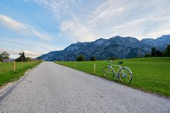Beautiful mountain valley/field road landscape with bike and blue sky in Austrian Alps. Austria, Salzkammergut stock photography