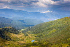 Beautiful  Mountain Valley with Lake in summer Stock Images