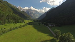 Beautiful Mountain Valley Road Landscape With Breathtaking Mountain Alps Backround View. Aerial: Drone Shot Of Beautiful Mountain Valley Road Landscape With stock video footage