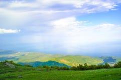 Beautiful Mountain Valley with Sunlight Stock Photo
