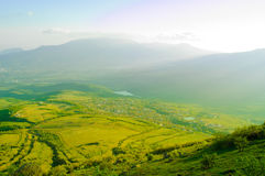 Beautiful Mountain Valley with Sunlight Stock Images