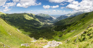 Beautiful mountain valley under blue sky Stock Images