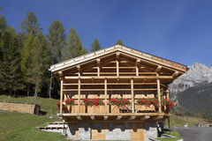 Beautiful Mountain Valley and Wood Chalet in the Dolomites Royalty Free Stock Image