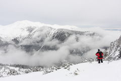 Beautiful mountain view with fog and snow Stock Photo