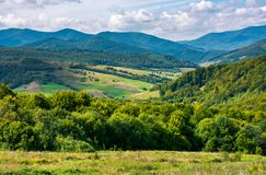 Calm and relaxing scene. Beautiful mountainous countryside. calm and relaxing scene. forested hill and rural fields in the distance stock photos