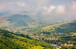 Beautiful mountainous countryside. Village in the valley. beautiful bright autumn morning with low clouds and haze Royalty Free Stock Image