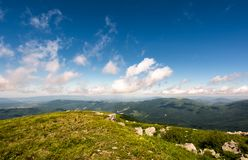 Beautiful mountainous landscape in summer. Lovely nature scenery observed from the top of a hill with giant boulders. fine weather with blue sky and some Stock Images