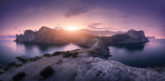 Beautiful mountains against colorful cloudy sky at sunset Royalty Free Stock Images