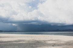 Beautiful mountains on beach with dark clouds, Krabi, Thailand. Royalty Free Stock Image