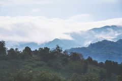 Beautiful mountains with clouds and fogs. Beautiful mountains with clouds and fogs landscape of Northern, Thailand Stock Photo