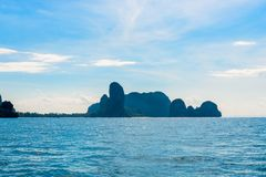 Beautiful mountains covered with green trees and blue calm sea o. N a sunny day, Thailand, Krabi province Royalty Free Stock Images