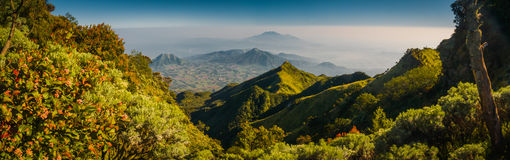 Beautiful mountains in Java. Panoramic photo of mountains surrounding Mount Merbabu near Yogya in central Java province in Indonesia. In this region, one can Stock Photo